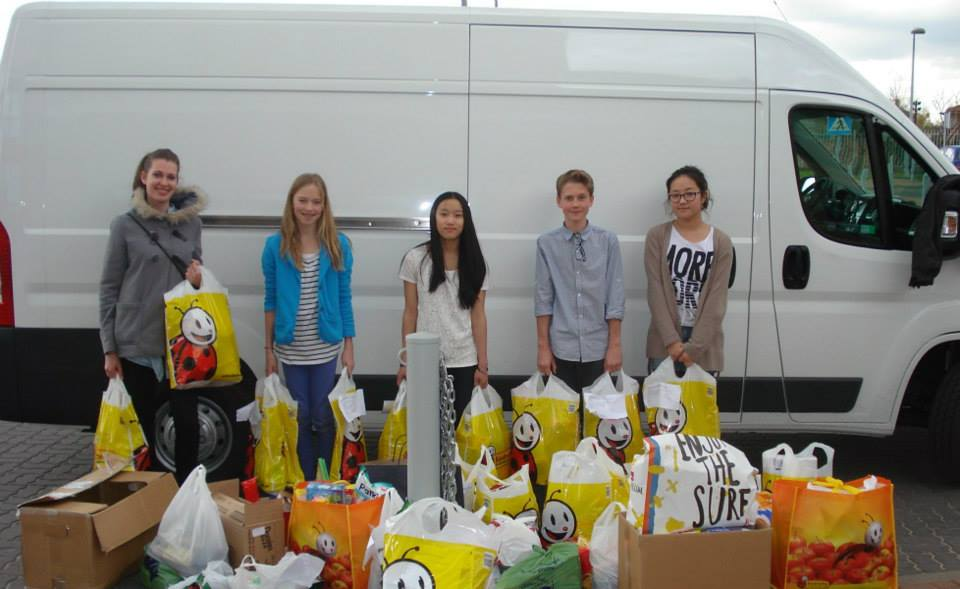 Local students deliver donated goods to Families in Crisis